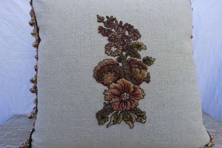 A pair of custom designed pillows by Melissa Levinson. 19th century metallic and chenille embroidered floral textile has been hand applied to a contemporary natural colored linen and finished with metallic cording and tassel fringe around the sides