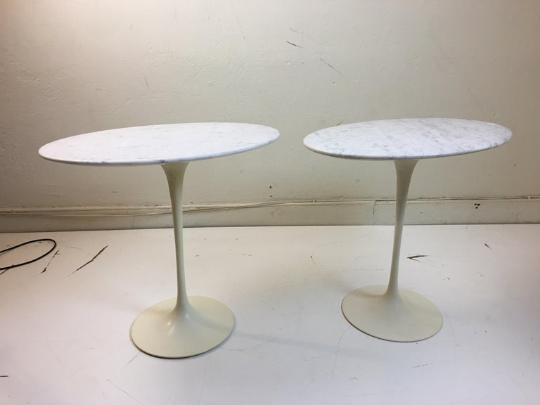 Eero Saarinen for Knoll marble oval side tables on cast iron bases. Bases form this early period are thinner than newer editions. Bought from original owner.