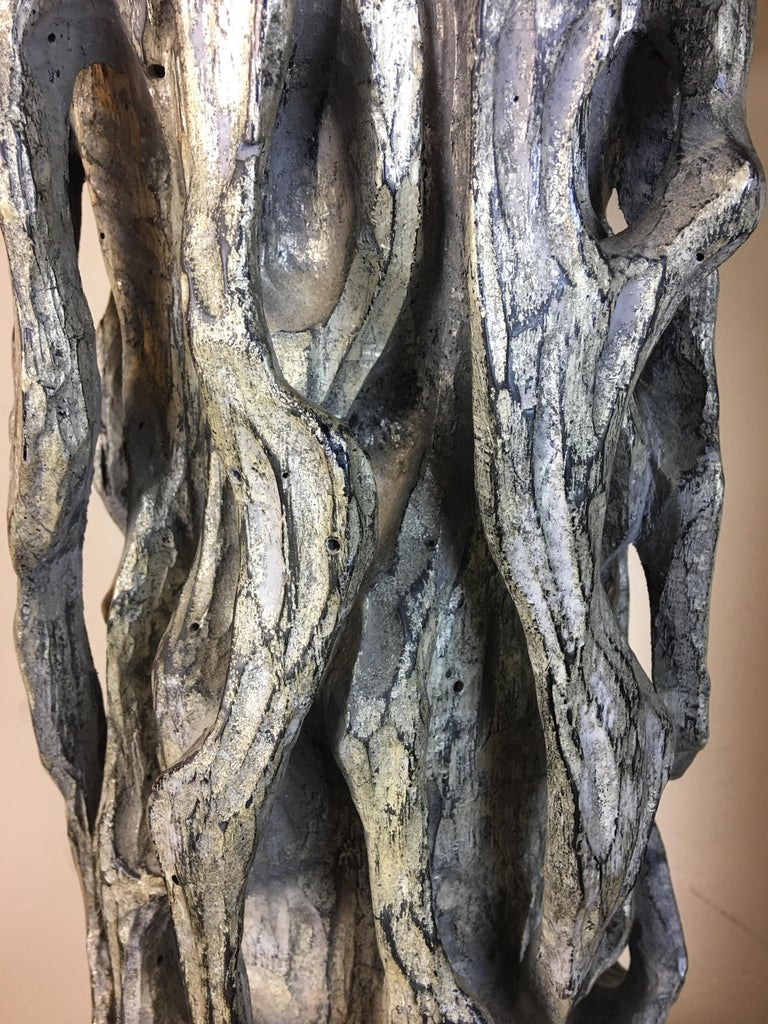 James Mont monumental carved tree trunk lamps poly-chromed with large newer gray shades (showing dents) and pictured for scale only. Very striking and in suburb original condition.
