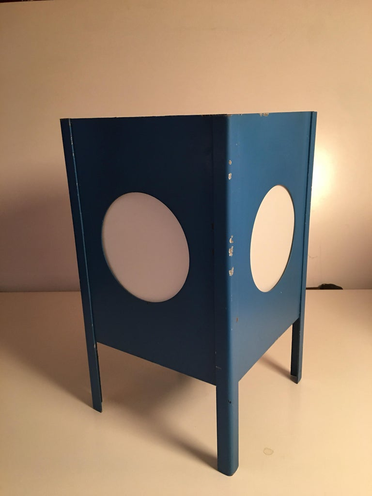 Metal cube lamps with velum covered porthole openings. Orange and blue lamps appear to be original. Black cube repainted to cover an original white lamp. Very interesting and never seen before from this 40 year Mid-Century Modern dealer. Original