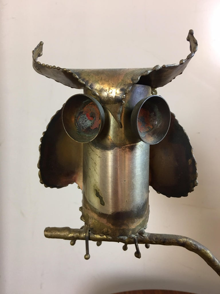 Curtis Jere owl dated 1969 and perched on a branch embedded in a quartz rock.