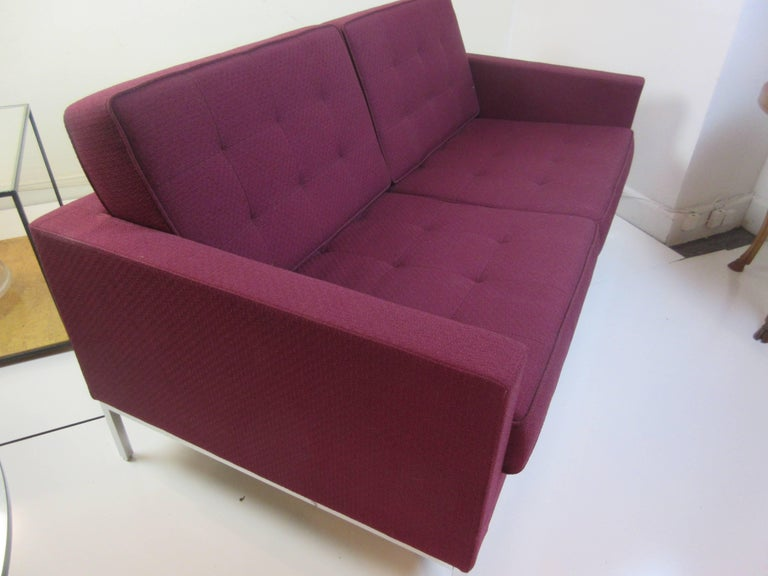 Florence Knoll settee in Knoll Rochelle purple fabric. Part of her 1954 series of seating for Knoll this is a 2010 addition and in perfect condition.
