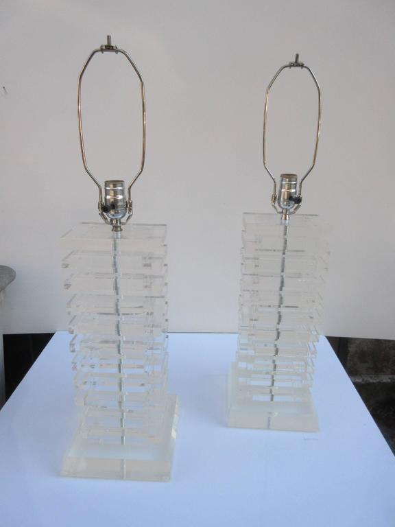 Beautiful, very clean pair of stacked Lucite table lamps. Each lamp is made up of 21 Lucite rectangular pieces plus base and Lucite finale. Lamps were taken apart and all Lucite polished. Lamps have new sockets and wiring!