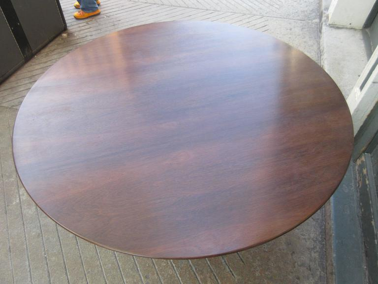 Warren Platner for Knoll 54 inch rosewood dining table. More rare than marble or laminate this rosewood table in is great condition both the top and the stainless pedestal.
