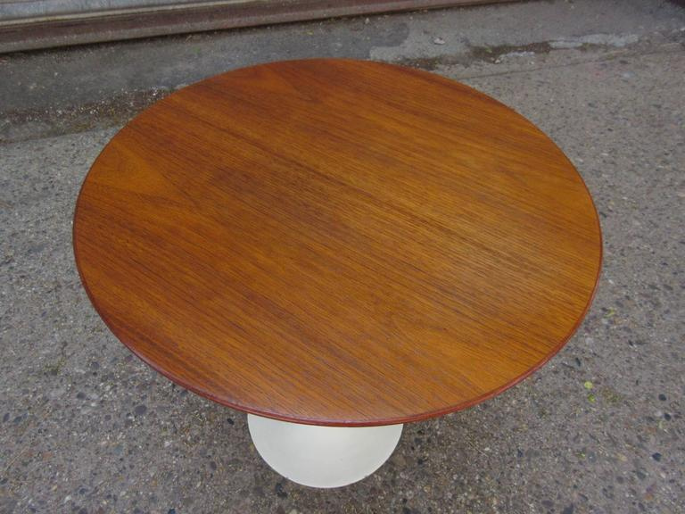 "Nice early production cast iron base Saarinen for Knoll tulip side table. Retains its early label. Top has been refinished, but base has original ivory paint in very nice shape, a few minor chips to rim as seen in photo. Measures: 20""."