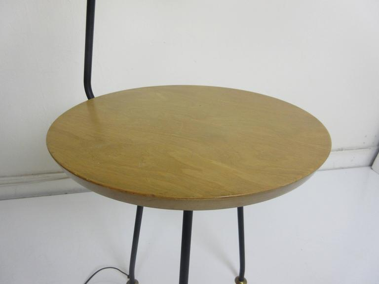 Great designed Luther Conover lamp table. Table sits on metal tripod legs with pivoting feet. Original finish on both wood and metal.