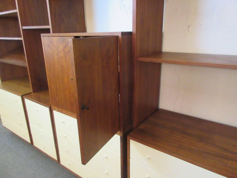 Hardwood house wall or room-divider shelving system with an infinite combination of possibilities. Unit is both for against a wall or freestanding as a divider. Cabinets can be positioned to face either direction when used as a divider. Included are