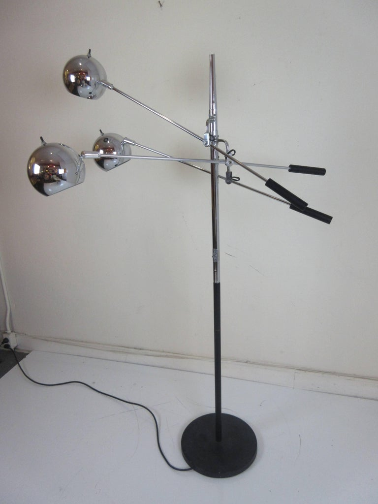 Robert Sonneman adjustable chrome floor lamp with three movable arms and shades. Switch on pole and individual shades. Black metal base and black weighted ends to each arm.