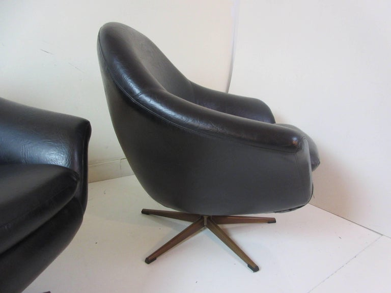 Overman Pair Of Swivel Chairs In Black Vinyl At 1stdibs