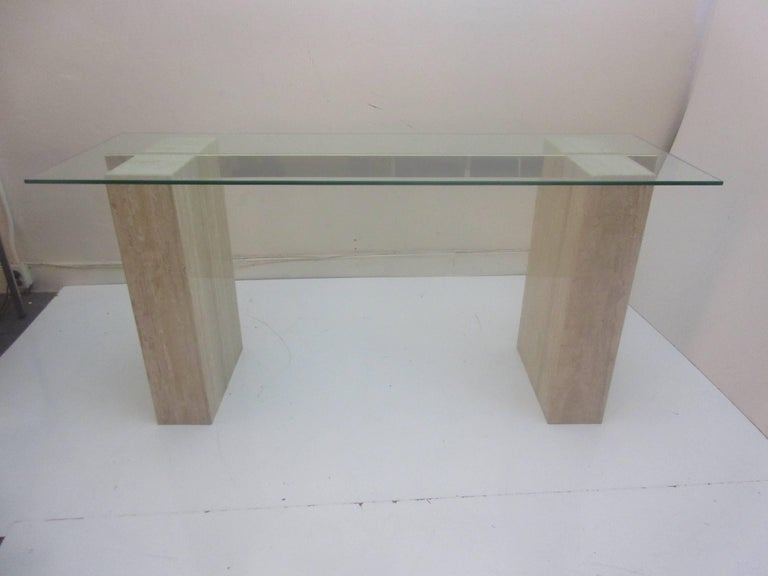 Artendi console table in travertine brass and glass. Elegant console in durable material that can get wet without damage.