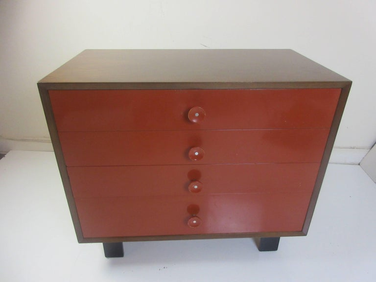 George Nelson for Herman Miller vanity chest of drawers in a walnut case with the original bittersweet red lacquered drawers and the # 6