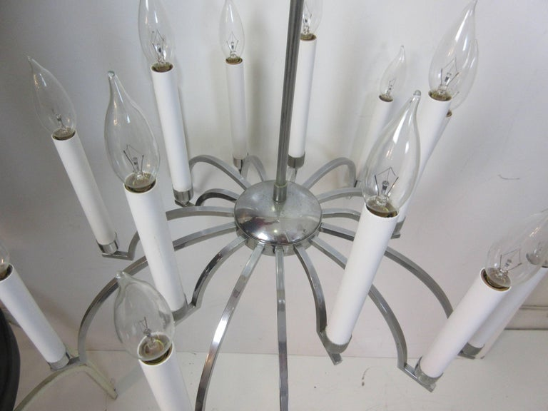 Gaetano Sciolari chrome chandelier with 16 candlesticks. Over 6 feet of chain with actual fixture being 25 inches tall.