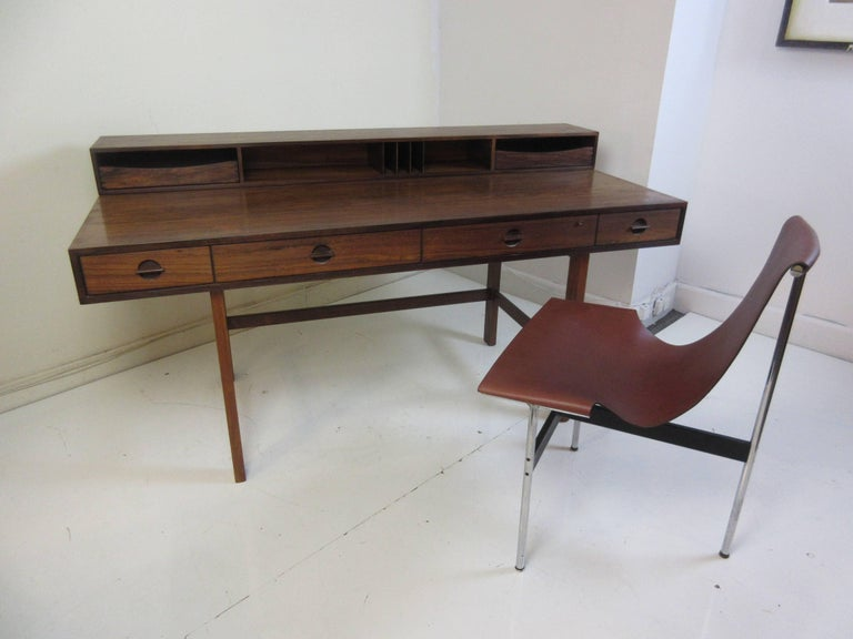 Jens Quistgaard for Lovig in rosewood flip desk . This example was purchased from the original owner architect who bought it in 1961. The upper section flips to enlarge the surface area and in doing so conceals the storage area on the back from