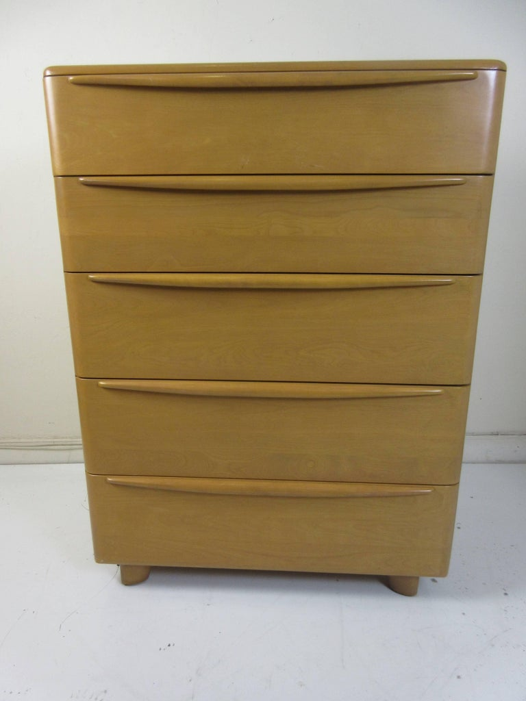 Heywood Wakefield encore tall chest of drawers in solid maple from 1952 and bought from the original family. Complete set available with storage headboard, low dresser with mirror, and nightstand (pictured) second nightstand in slightly different