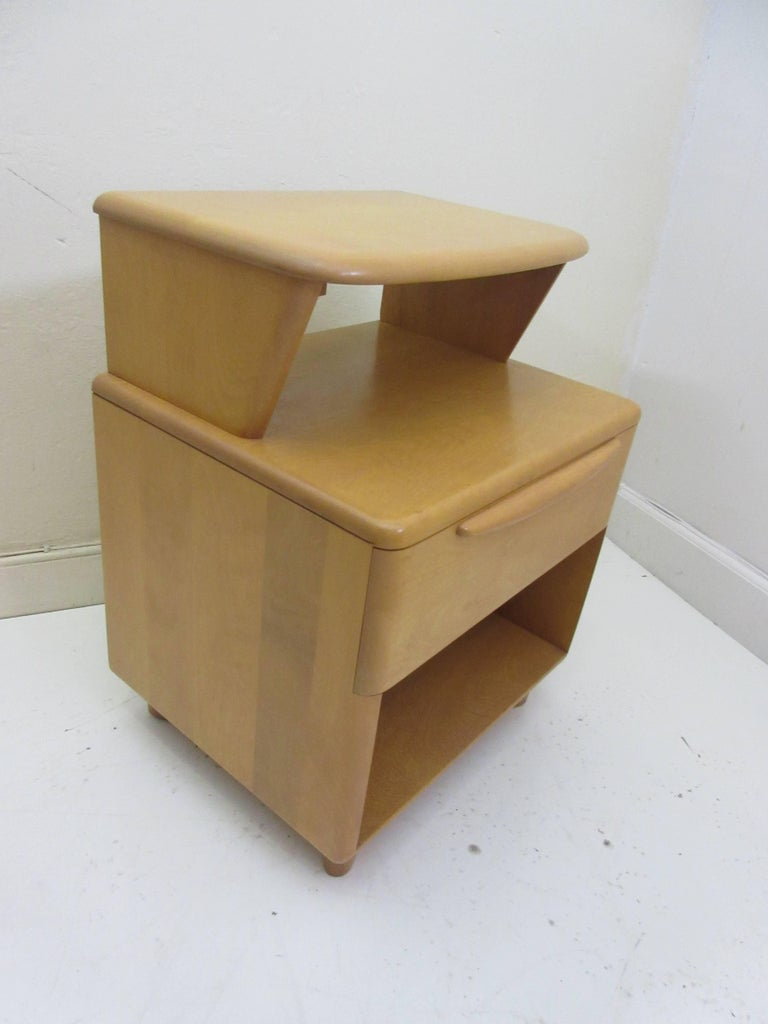 Heywood Wakefield encore nightstand in very nice condition. Second one available with a slightly different tone. Listing is for a single nightstand. Entire encore bedroom set available.