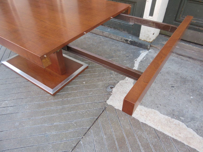 Milo Baughman for Founders walnut extension dining with two leaves totally refinished with aluminium trim polished. Table's dimension listed are for the extended size. Closed the table is 68 x 38. Clearance for arm chairs under the table is 26.5