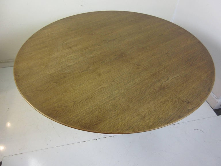 Eero Saarinen Knoll walnut pedestal 54 inch dining table.