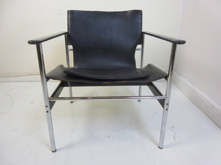 Charles Pollack 657 Knoll sling chair in black totally original and dated Jan 1978. Normal 40 year wear to leather and excellent chrome and plastic arm rests are perfect.