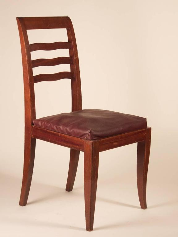 French Art Deco dining chairs, set of six, in mahogany, circa 1938.  Please note that these chairs are unrestored in the photographs.  **PRICE includes proper restoration, refinishing and reupholstering with buyer supplied fabric.