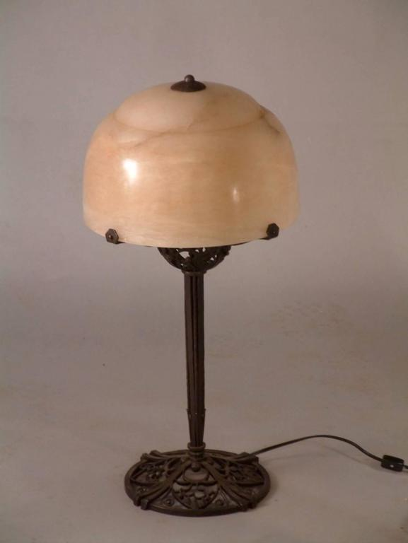 "Classic French Art Deco table lamp in forged iron with alabaster shade by Raymond Subes, circa 1923. Measures: About 25"" high.