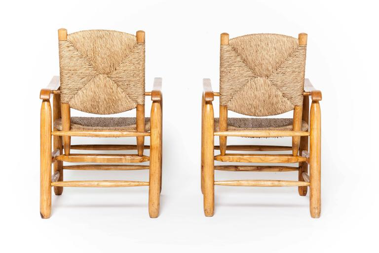 Charlotte Perriand, pair of rush armchairs.