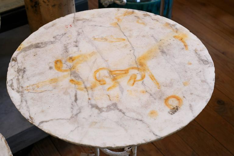 Antique white iron gueridon table with raw marble top from France, circa 1900. Original paint.