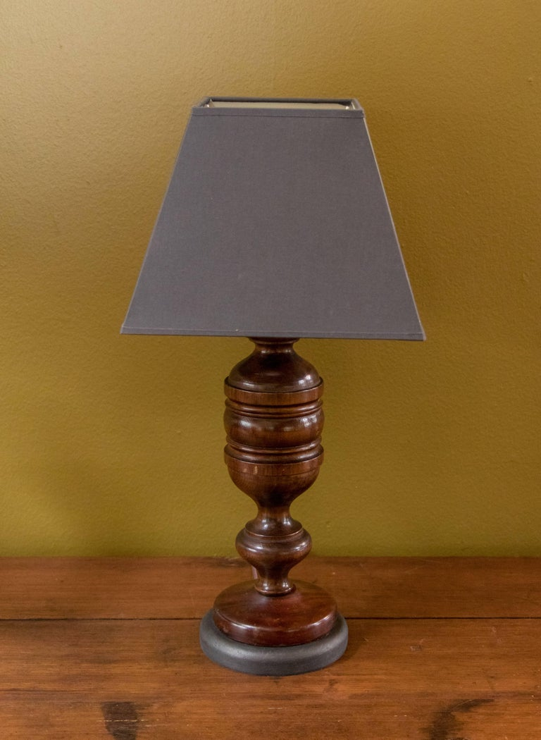 Charming pair of dark mahogany wood hand-turned table lamps with painted dark grey wooden bases from Belgium, circa 1920s. Comes with two custom-made Belgian linen shades in a dark grey color. Perfect size for bedside lamps. Newly wired with all UL