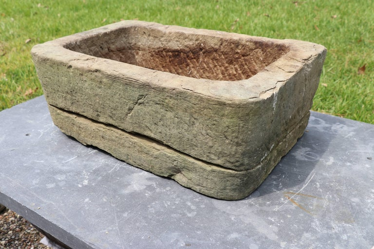 Hand-carved Belgian stone planter (circa 1900): rectangular in shape, this limestone, or bluestone, is comprised of two pieces. Top portion fits snugly on the bottom slab. Item is not meant to be a vessel for holding water.
