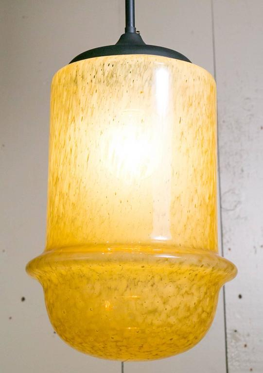 Mid-Century Modern yellow hand-blown glass light by Mazzega.  Interesting speckled color variations in the glass.  Glass dome rests on a on dark painted metal rod with one porcelain Edison Socket.  Can take up to a 100 watt bulb. Newly rewired in