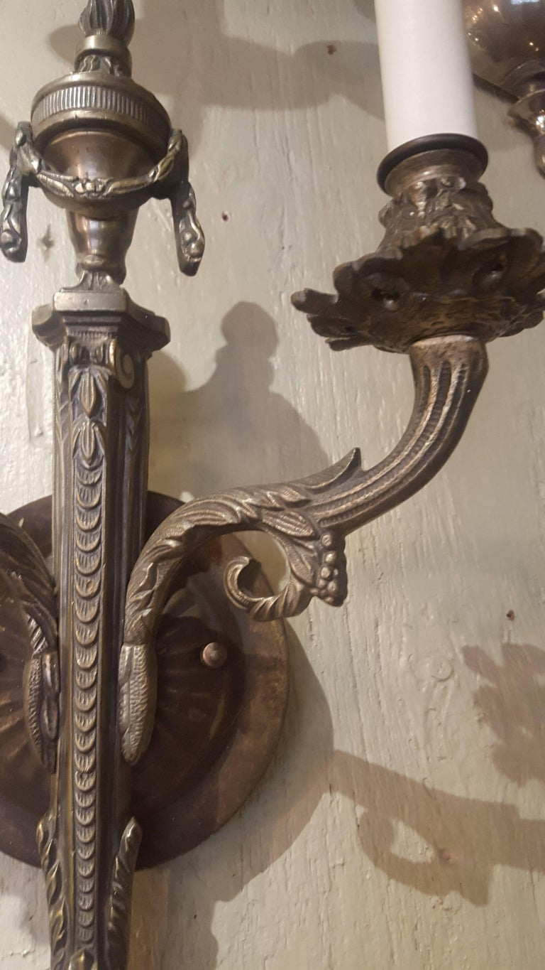 Pair French Two-Arm Empire-Style Bronze Sconces with Urn and Swag Detail For Sale 1