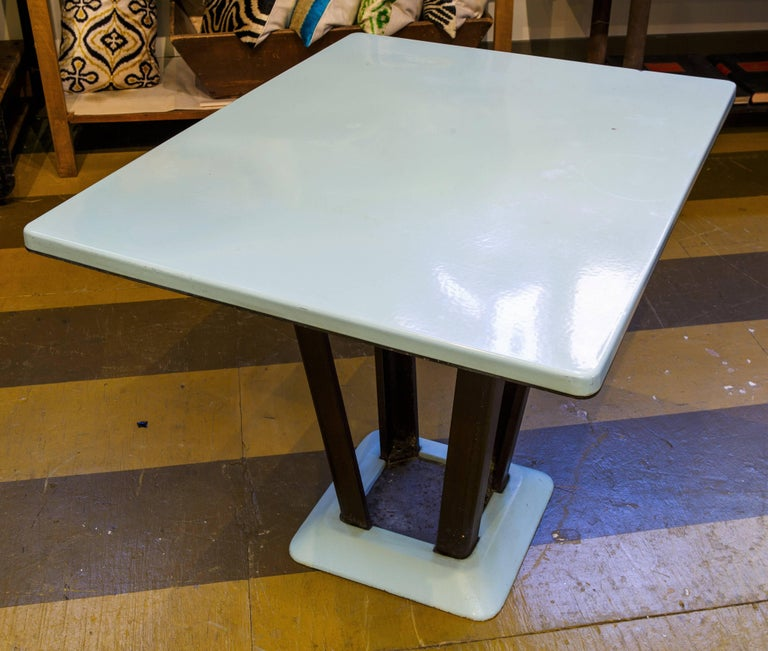 Fun, unusual and rare Art Deco table.  Porcelain enamel on iron top with black iron legs and matching blue base. This table can go in almost any room. It has a beautiful light blue color.