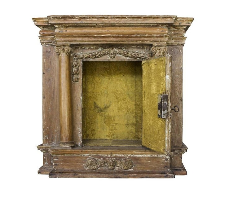 18th century French reliquary with small door flanked by Iconic columns and floral swags.