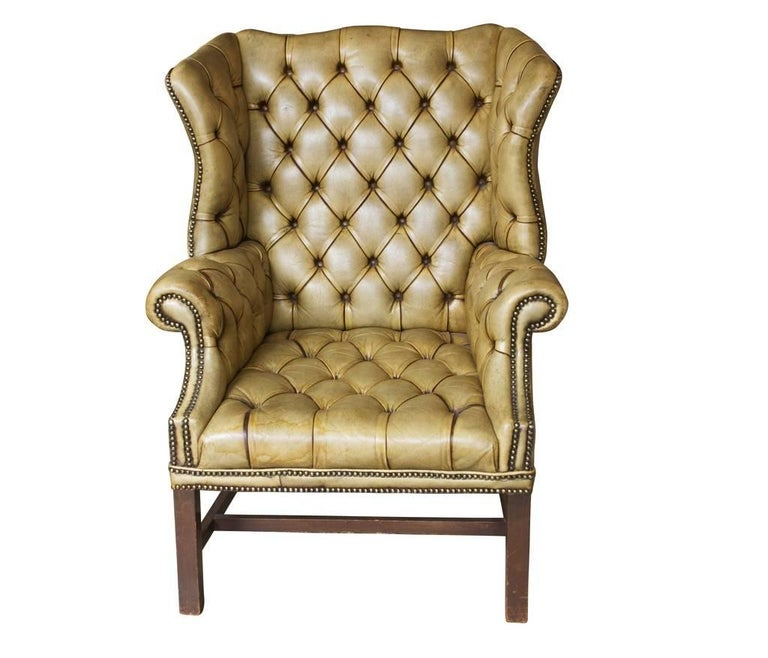 Late 19th century English leather wingback chair in original tufted leather.