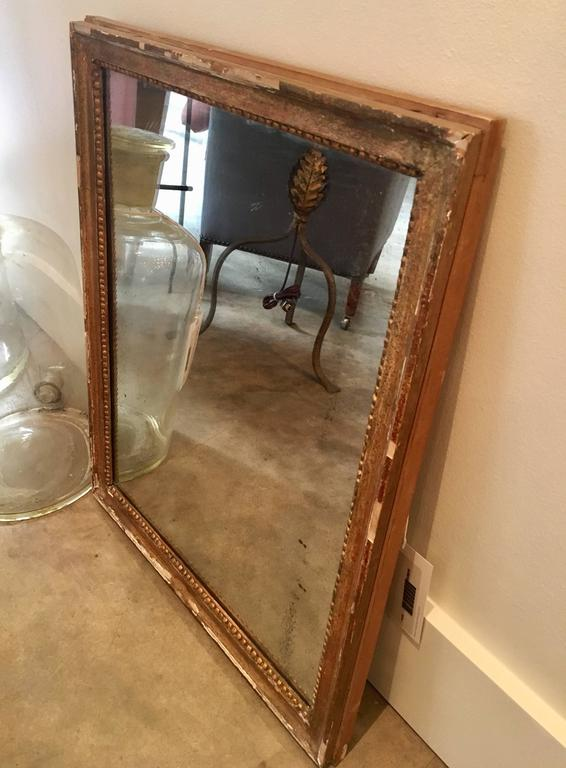 "Petite 19th century mirror with giltwood bead frame, original plate. Dimensions: 20.5"" W x 1.5"" D x 26"" H."