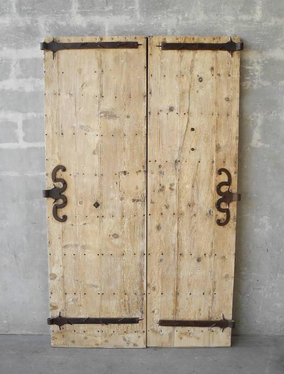 This is a simply beautiful pair of 18th century entrance doors from a property in St. Marcellin, a town in the Rhone-Alpes region of France. These doors include original hardware that has been refurbished, making for special iron detailing all