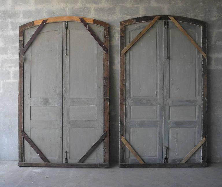 This is a statement set of two pairs of antique, 18th c. doors from a