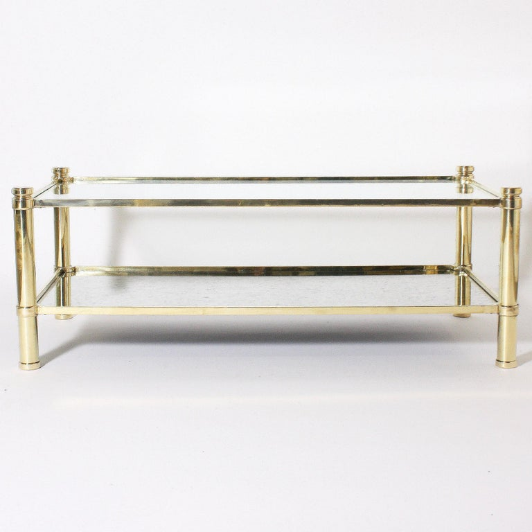 Bronze coffee table with glass shelves in the style of Jacques Quinet, circa 1960.