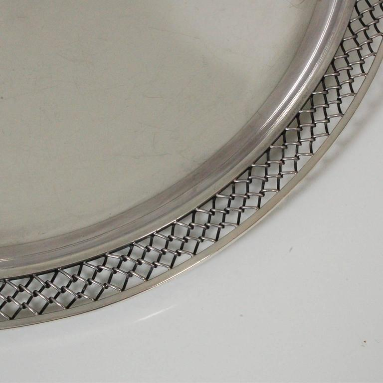 Large platter or tray designed by Svend Weihrauch for Hingelberg Studios. Sterling silver hammer made, with polished top. Chain link decoration edging, stamped on bottom with manufacturer's and silver mark. Silver weight 3.3 kg/7.2 lbs.