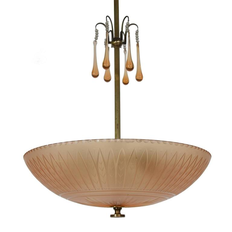 Cut and polished satin shade in rio brown glass. Oxidized brass fittings and six drop glass ornaments.