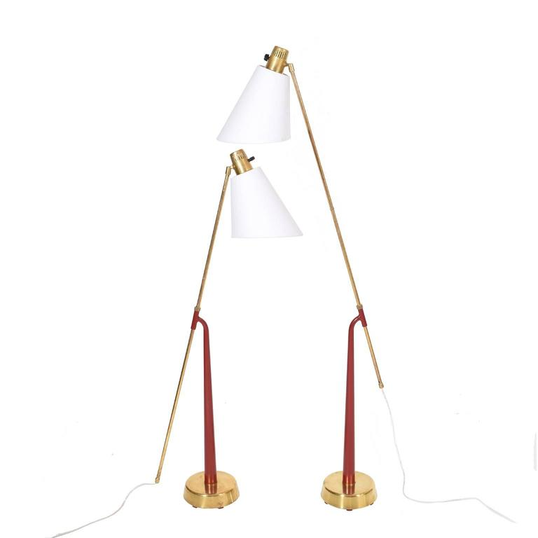 Pair of adjustable lamps, brass and red painted metal stem. Height and shades adjustable. Brass base. Stamped on base
