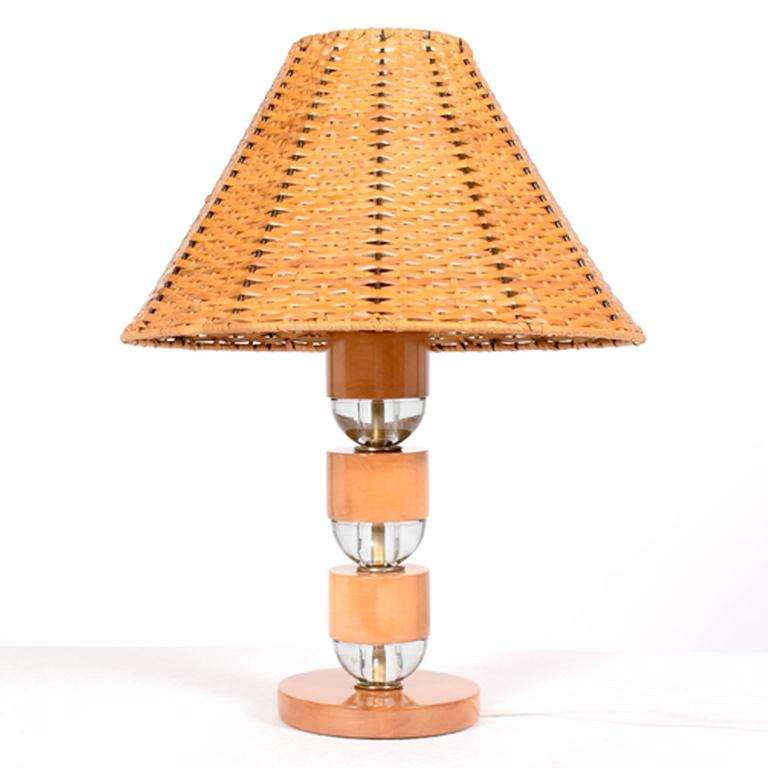 Base made of solid maple and glass spacers with cane lampshade. Wood has been restored, rest is all original.