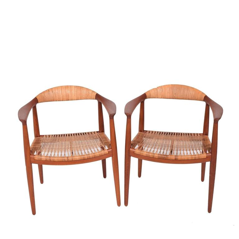 Solid teak with cane back and seat marked Johannes Hansen, Denmark.