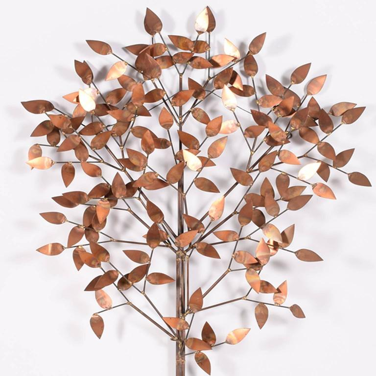 Signed: c jere; wall-mounted sculpture of a tree in copper.