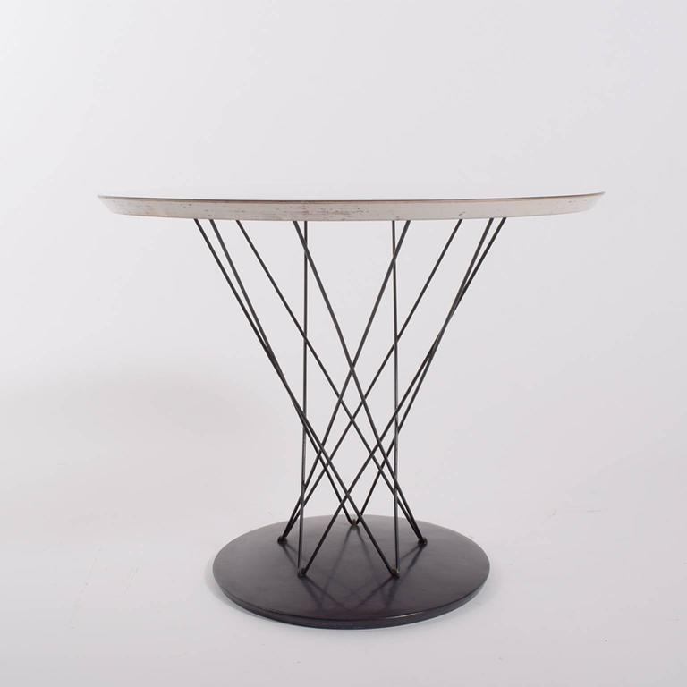 All original condition Cyclone table. Steel wire and base with black finish; white laminate top.
