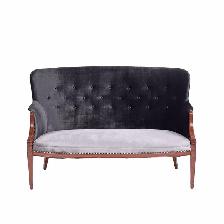 Solid mahogany two-seat sofa designed and made by Frits Henningsen in the 1940s. Two-tone velour upholstery with black upper and silver seat.