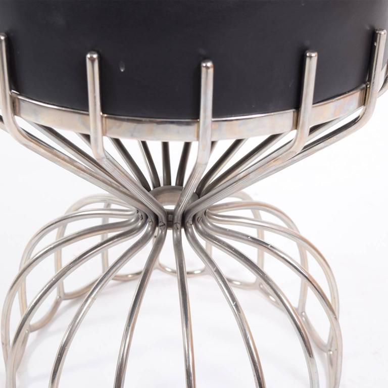 Unique and elegant French stool with bent stainless steel frame. Cushion upholstered with black leather.
