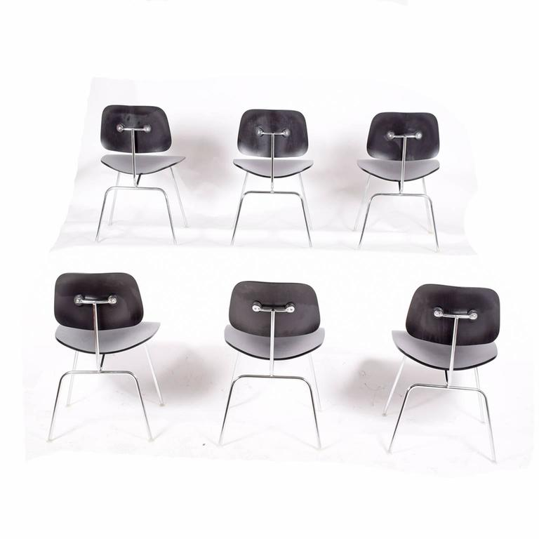 Black stained plywood on chrome frame dining chair metal. Manufactured by Herman Miller.
