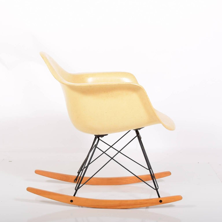 Original fiberglass armed shell on black wire base with birch rocker struts and large rubber mounts. Marked on bottom, Herman Miller. The chair was on carpet most of its life.