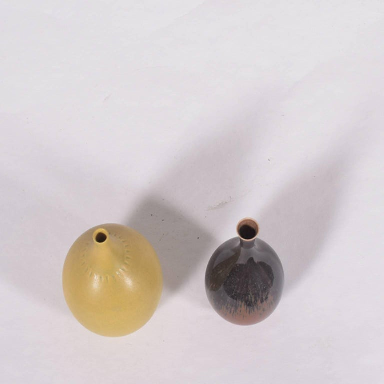 """Berndt Friberg was known for his delicate and beautiful shapes and glazings. He designed about 50+ different mini vases and bowls.  Yellow vase: 4"""" height and 2.75 diameter."""