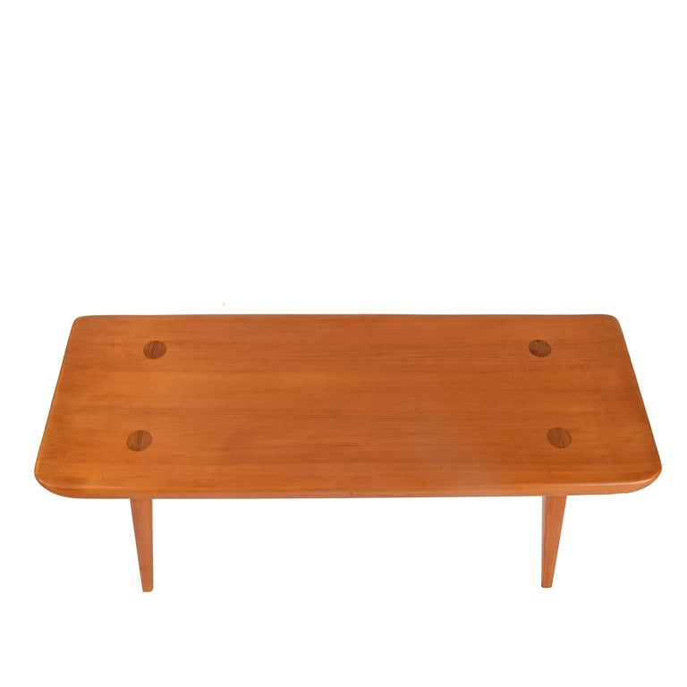 Bench features curved ends and four legs. Produced by Svensk Fur in Sweden. Solid pine with Illum Bolihus tag on the bottom.